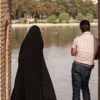 "An Iranian Man And Woman Standing In An Archway On Si-o-se Pol Bridge Look Over The Zayandeh River In Isfahan, Iran On August 4, 2008. The Woman Is Wearing A Chador, And The Man Is Wearing Pants And A Short Sleeve Shirt. Si-o-se Pol Bridge, Which Means ""33 Bridge"" Or The ""Bridge Of 33 Arches"", Is One Of Isfahan's Most Famous Landmarks. It Was Commissioned In 1602 By Shah Abbas I."